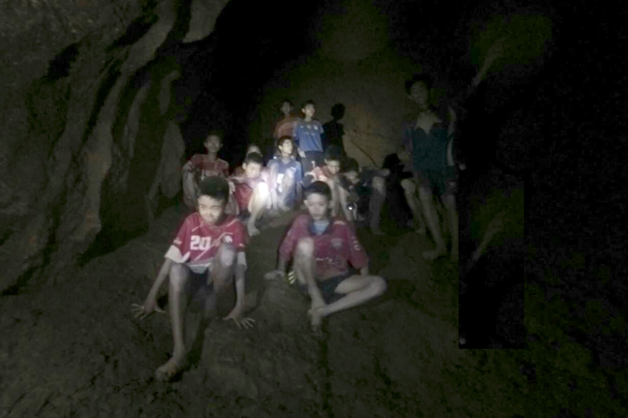 This image, taken from video on July 2, shows the boys trapped in the cave.
