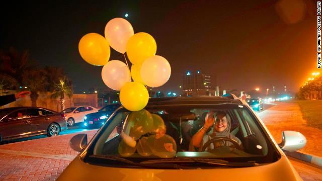 A Saudi women and her friends celebrate her first time driving in Khobar city, in the east of the country, on her way to Bahrain.