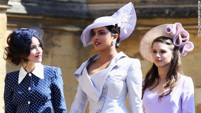 Actresses Abigail Spencer and Priyanka Chopra arrive wearing shades of blue and purple -- popular spring-time colors at this year's royal wedding.