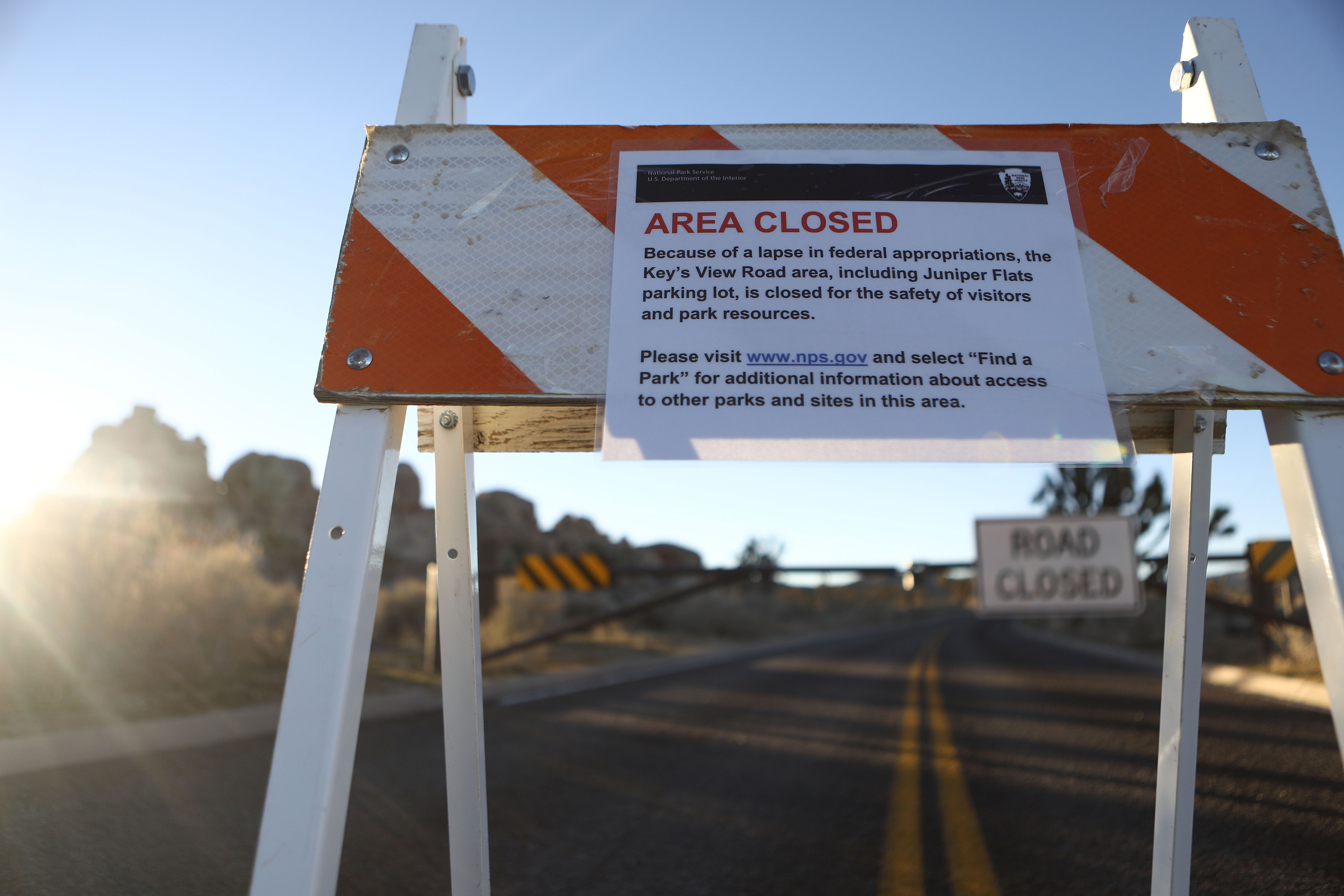 An 'Area Closed' sign is posted in front of a closed section of road at Joshua Tree National Park on Jan. 4
