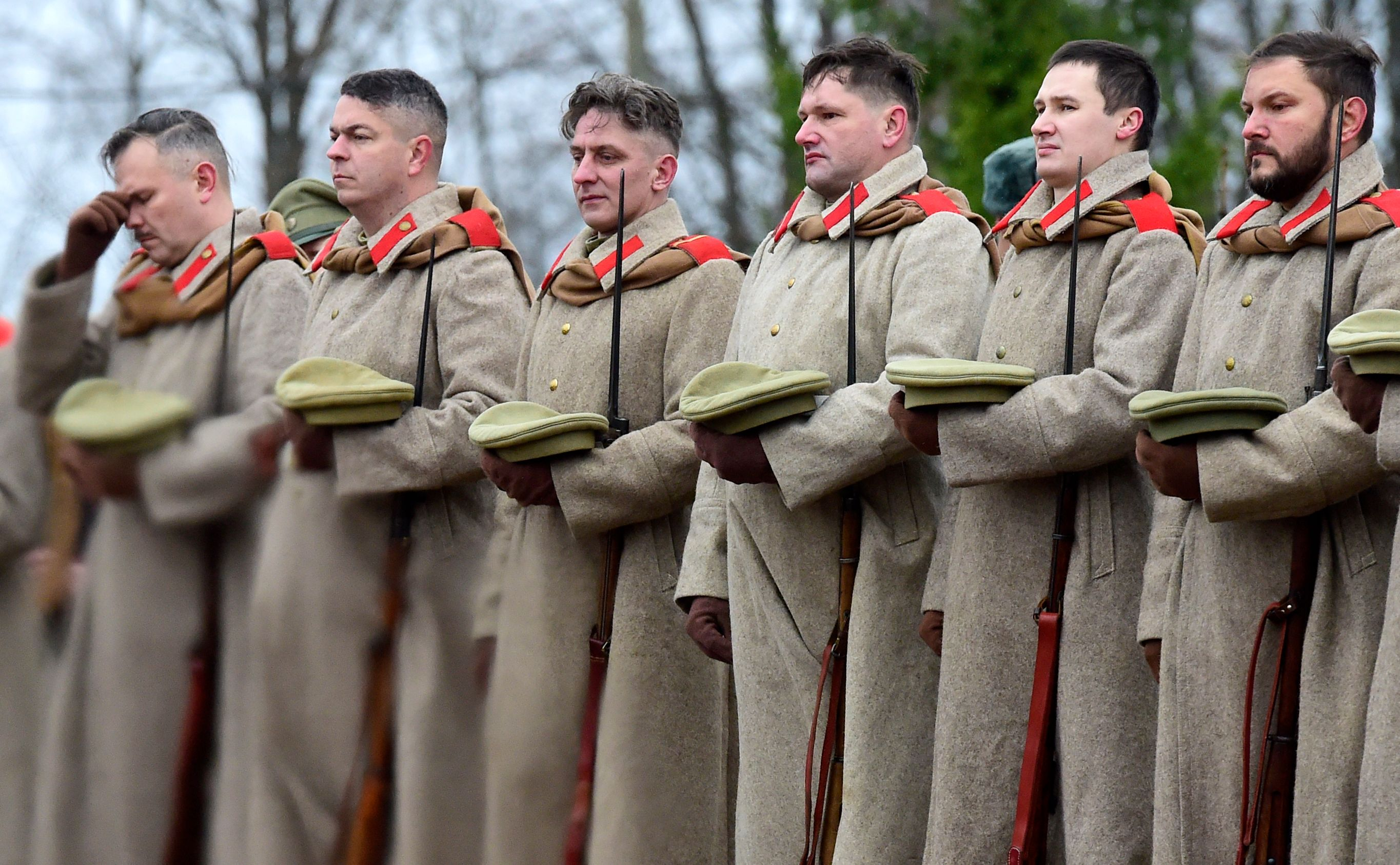 Members of a military history club wearing World War I uniforms attend a ceremony outside Saint Petersburg.