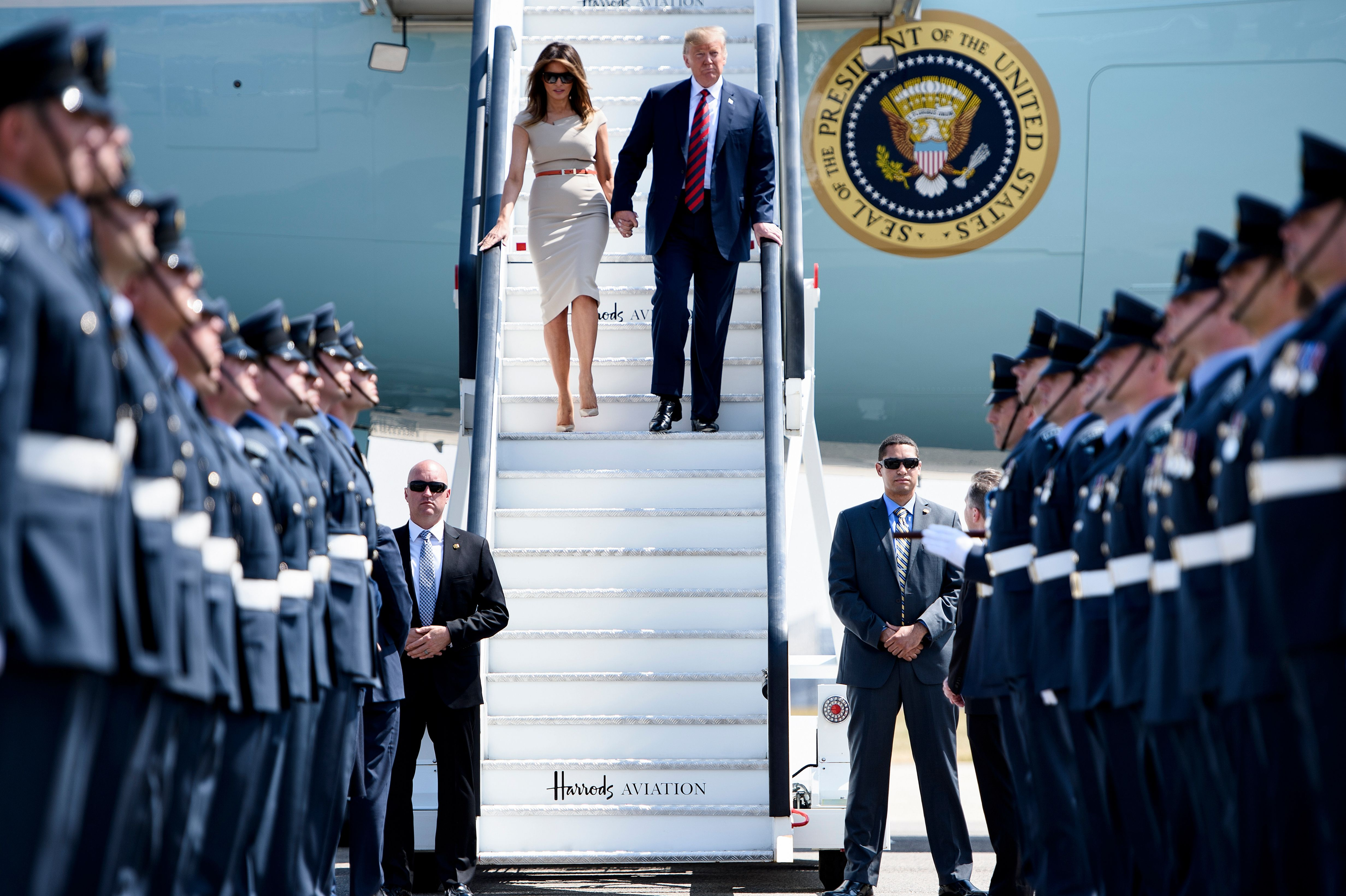 Trump and the first lady disembark Air Force One at Stansted Airport, north of London, on Thursday.
