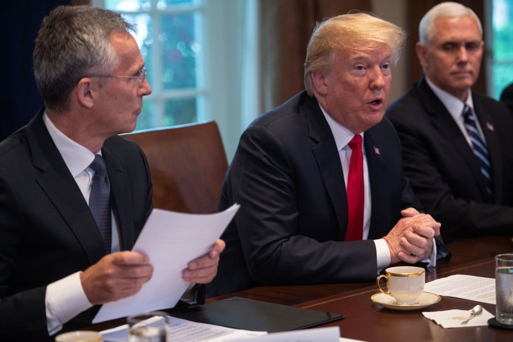 President Donald Trump (C) meets with NATO Secretary General Jens Stoltenberg (L) as Vice President Mike Pence looks on in the Cabinet Room at the White House in Washington, DC, on May 17, 2018.