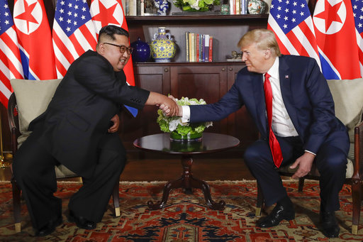 US President Trump shakes hands with North Korea leader Kim Jong Un during their first meetings at the Capella resort on Sentosa Island Tuesday, June 12, 2018 in Singapore.