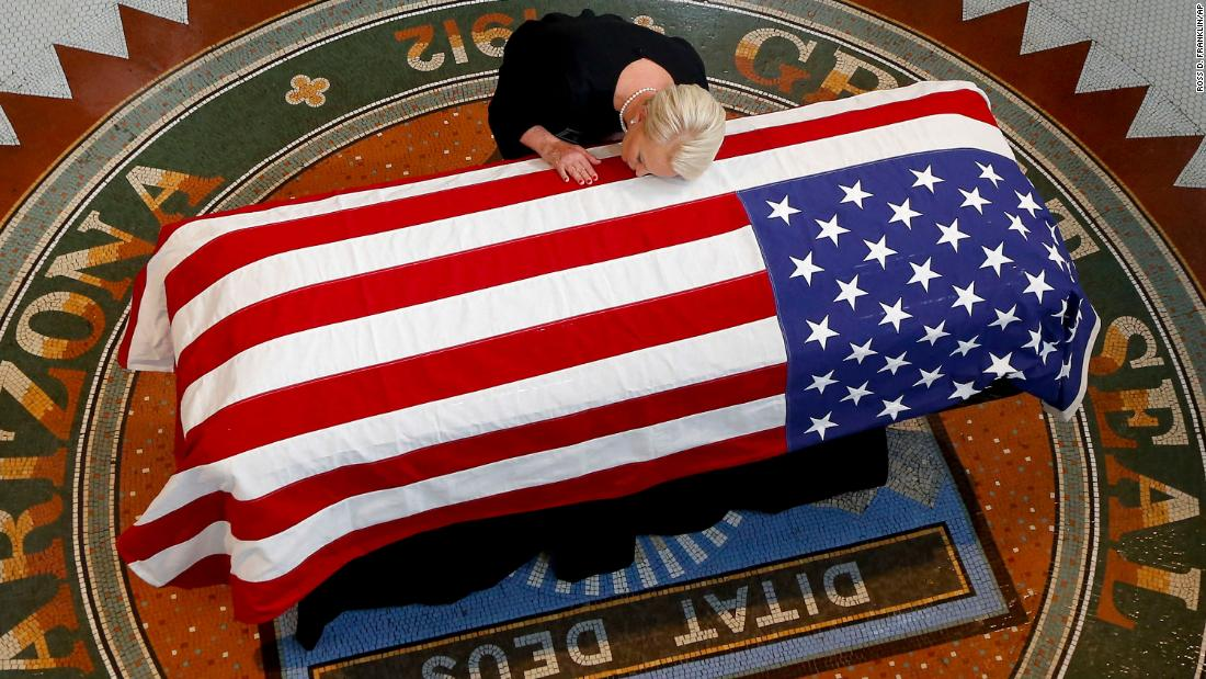 Cindy McCain, wife of Sen. John McCain, lays her head on his casket during a memorial service at the Arizona Capitol in Phoenix on Wednesday, August 29.