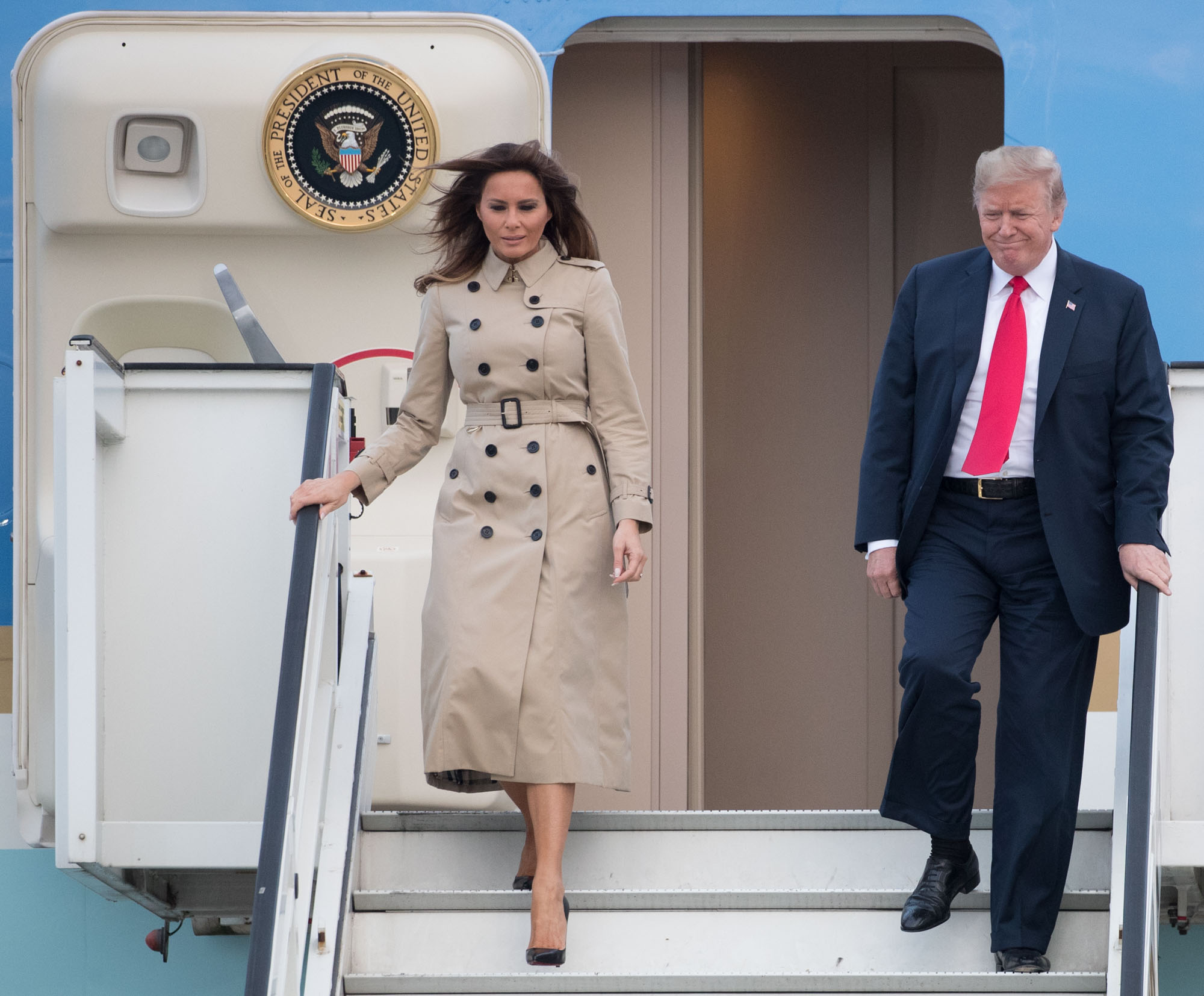 President Trump and Melania Trump disembark from Air Force One as they arrive in Brussels on Tuesday
