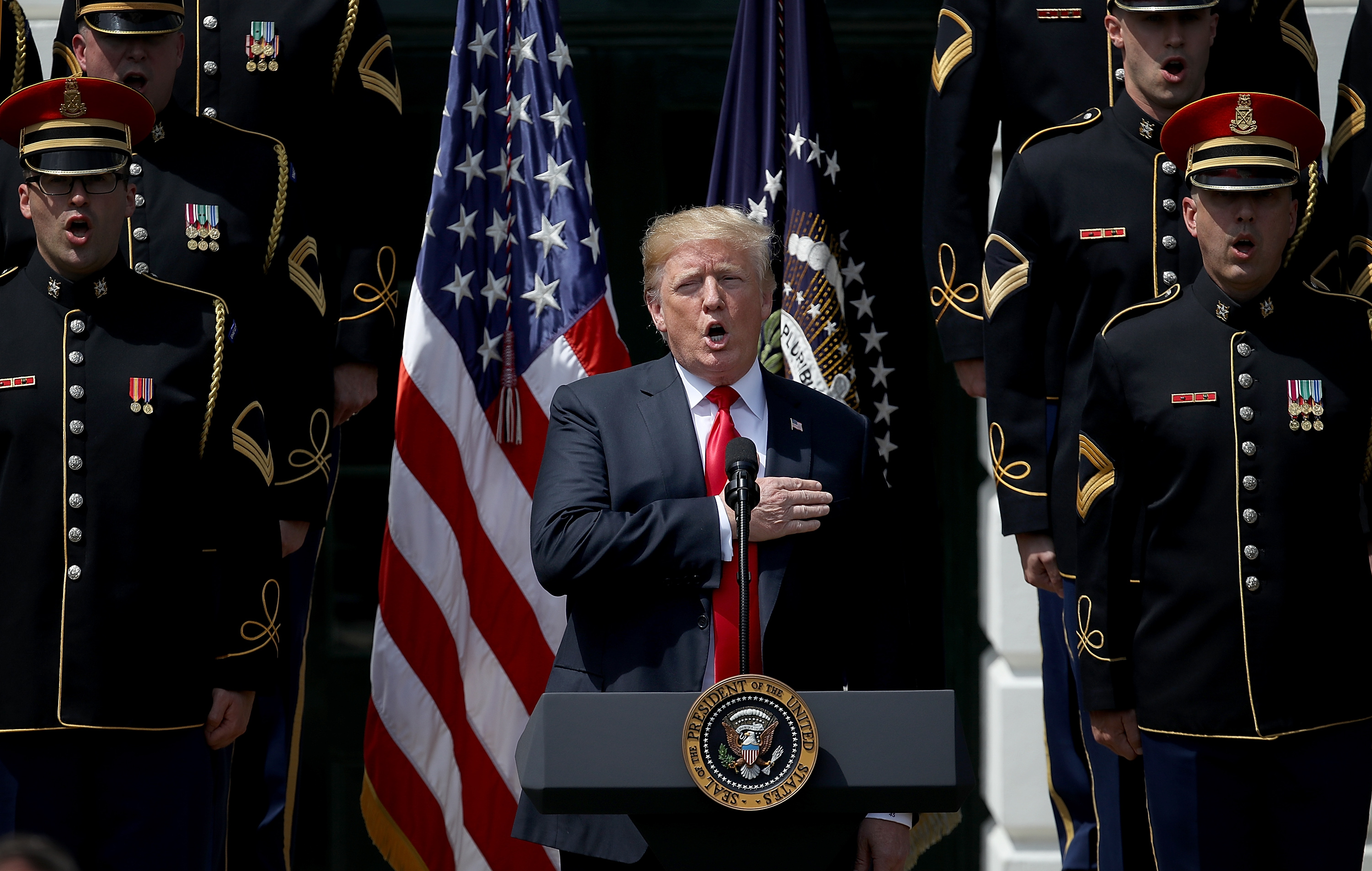 Trump sings the national anthem with a US Army chorus during a 'Celebration of America' event on the south lawn of the White House June 5, 2018.