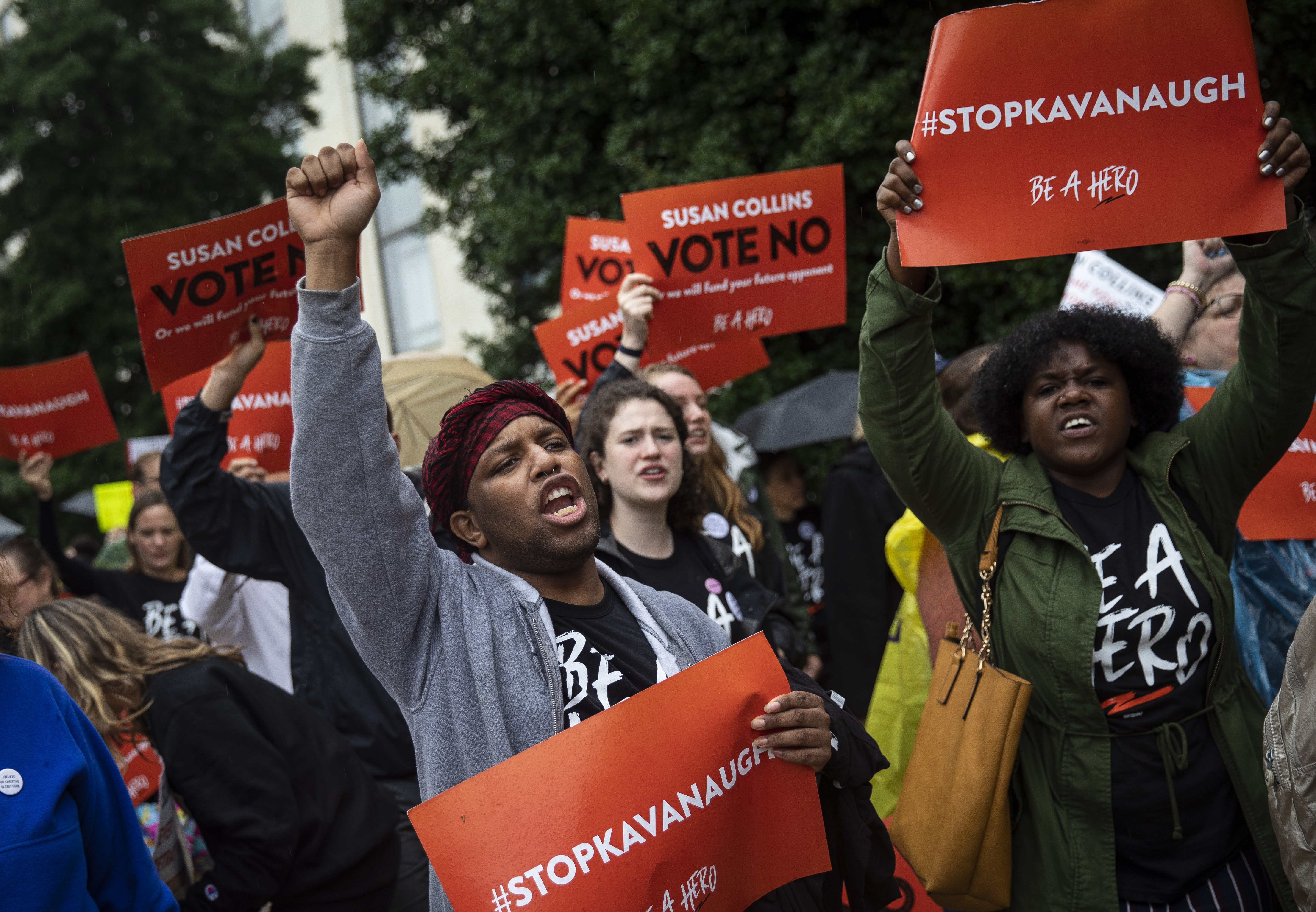 Protestors rally against Supreme Court nominee Judge Brett Kavanaugh as they make their way from the Supreme Court to the Hart Senate Office Building on Capitol Hill on Monday.