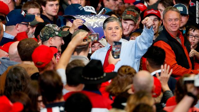 Sean Hannity meets with members of the audience before the start of a campaign rally on Monday with President Donald Trump.