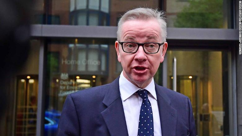Michael Gove talks to reporters outside the Department for Environment, Food and Rural Affairs