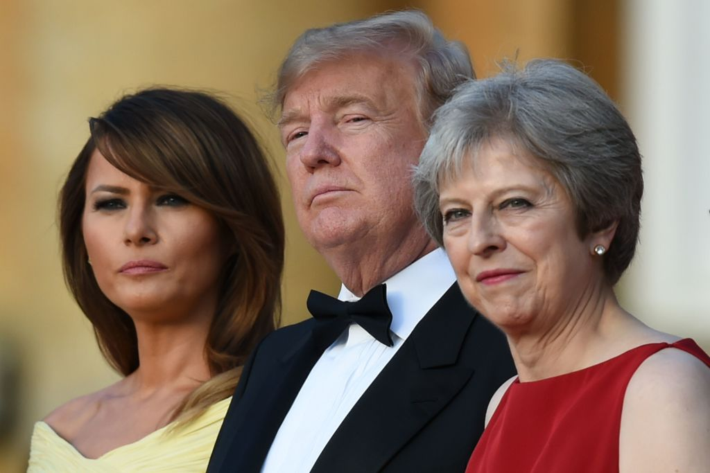 First lady Melania Trump, US President Donald Trump and Britain's Prime Minister Theresa May stand on the steps of the Great Court at Blenheim Palace on July 12, 2018.