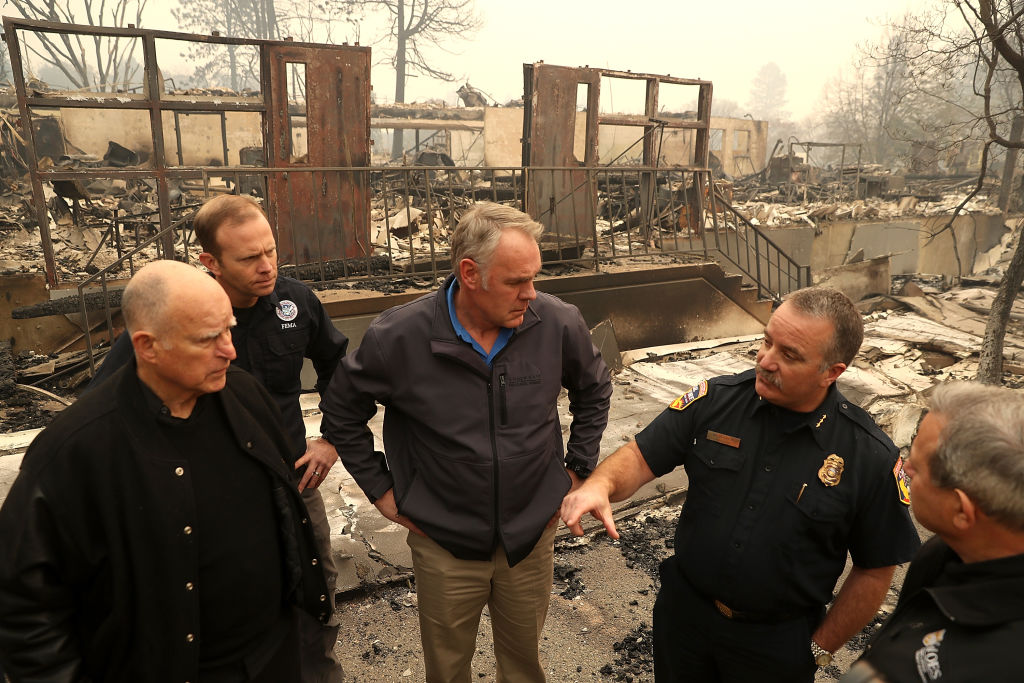 California Gov. Jerry Brown, FEMA Administrator Brock Long and US Secretary of the Interior Ryan Zinke tour a school burned by the Camp Fire on Nov. 14, 2018 in Paradise.