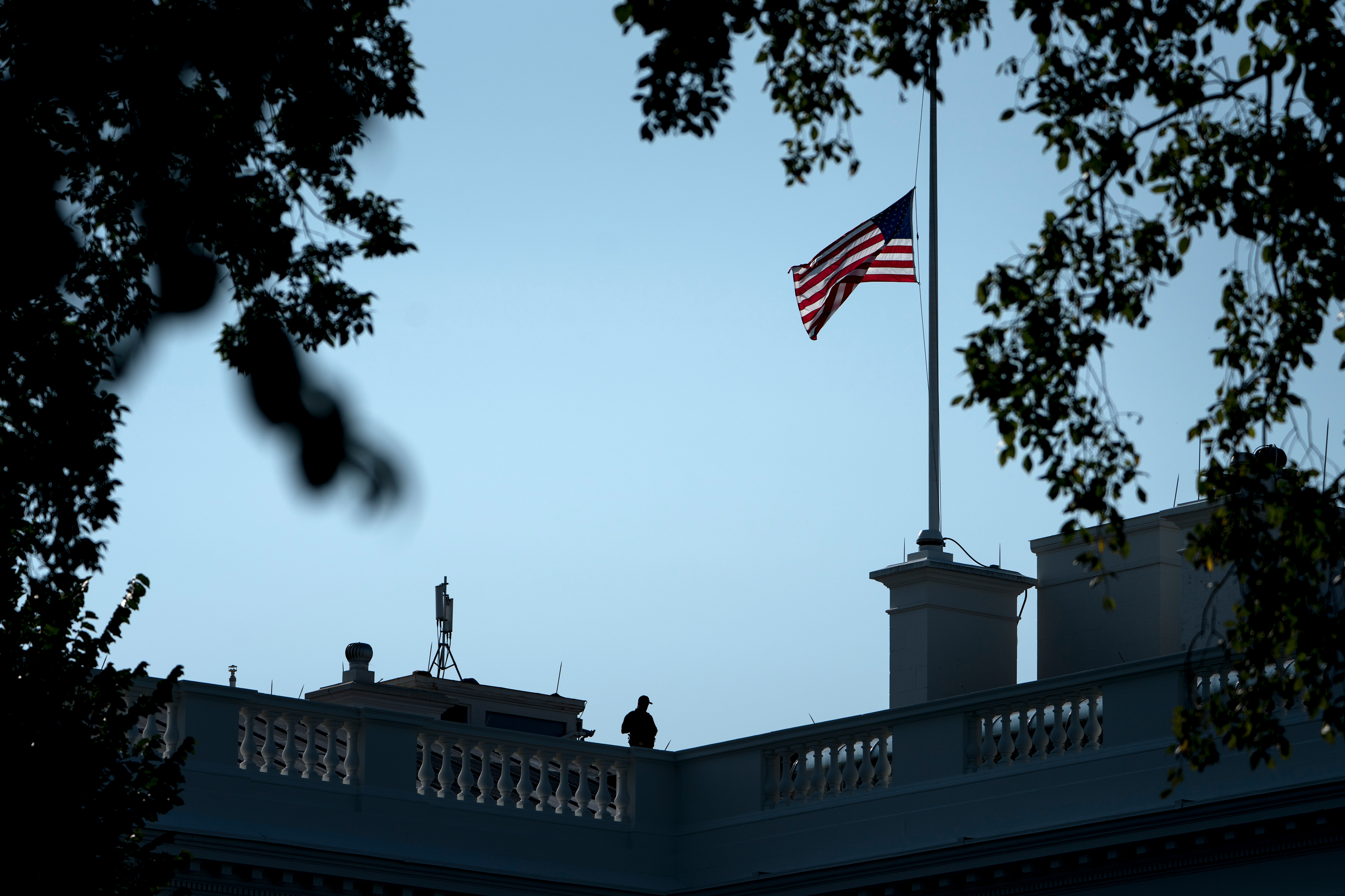 The flag over the White House flies at half staff Sunday after the death of Senator John McCain.