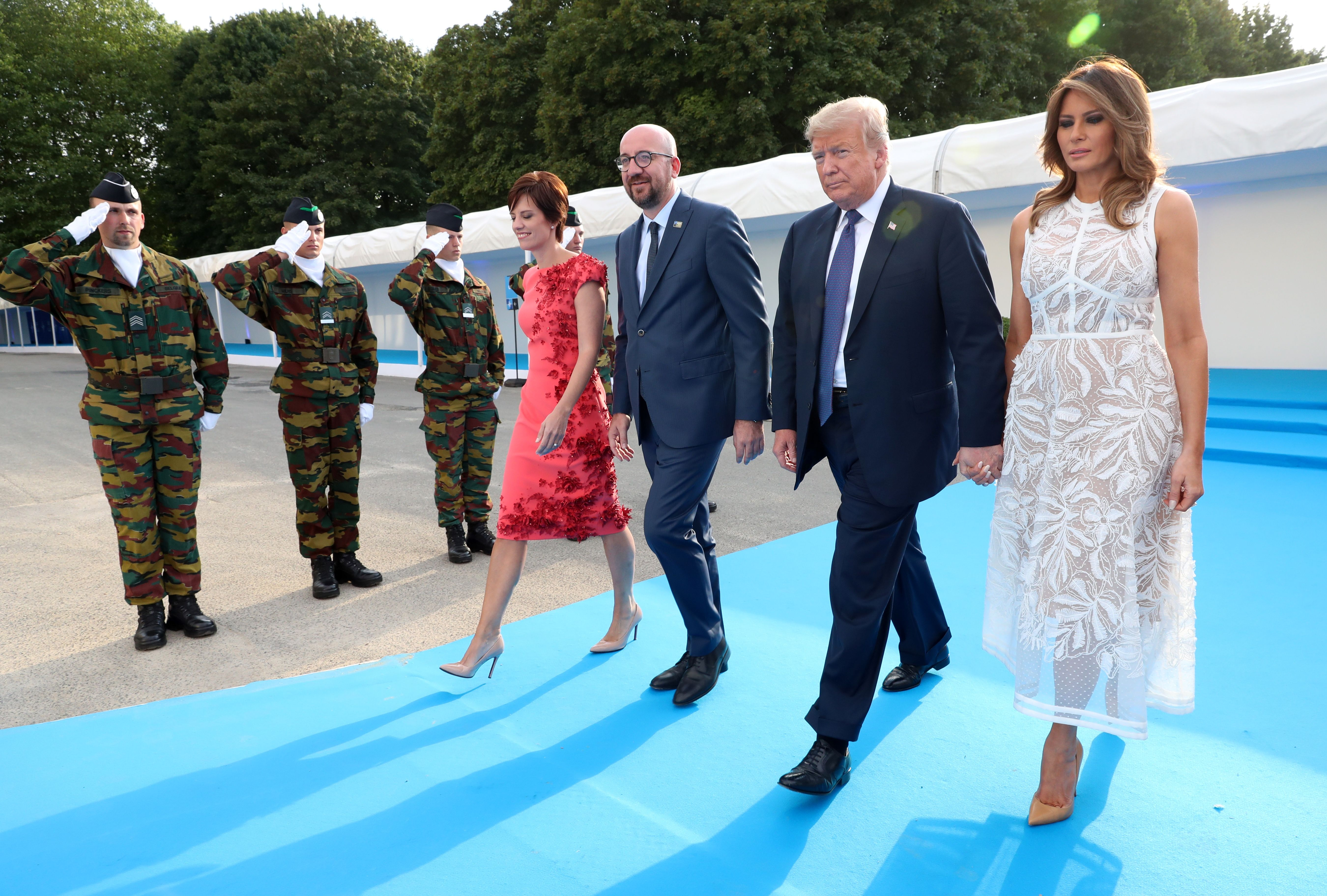 (Left to right) Belgian Prime Minister's partner Amelie Derbaudrenghien, Belgian Prime Minister Charles Michel, President Trump and Melania Trump arrive for the NATO dinner