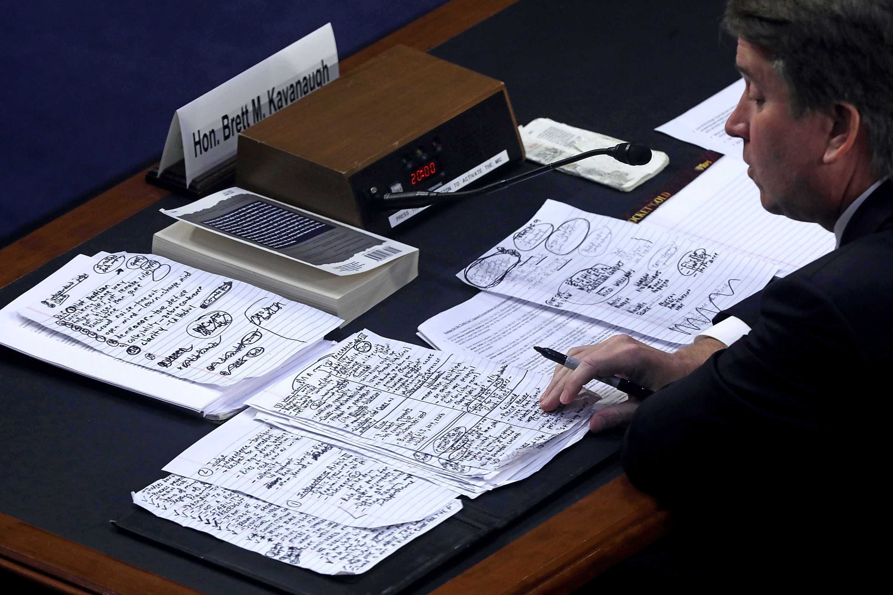 Supreme Court nominee Judge Brett Kavanaugh looks over his handwritten notes while testifying before the Senate Judiciary Committee on Sept. 6, 2018 in Washington, DC.