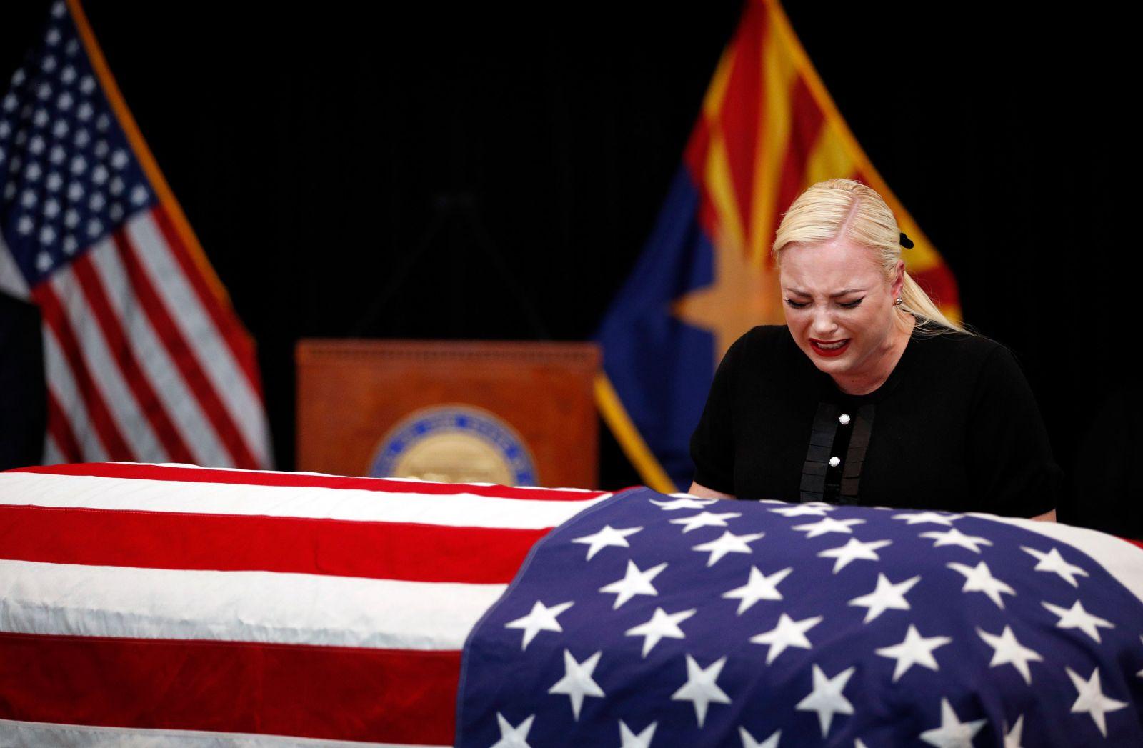 Meghan McCain, daughter of Sen. John McCain, cries at the casket of her father.