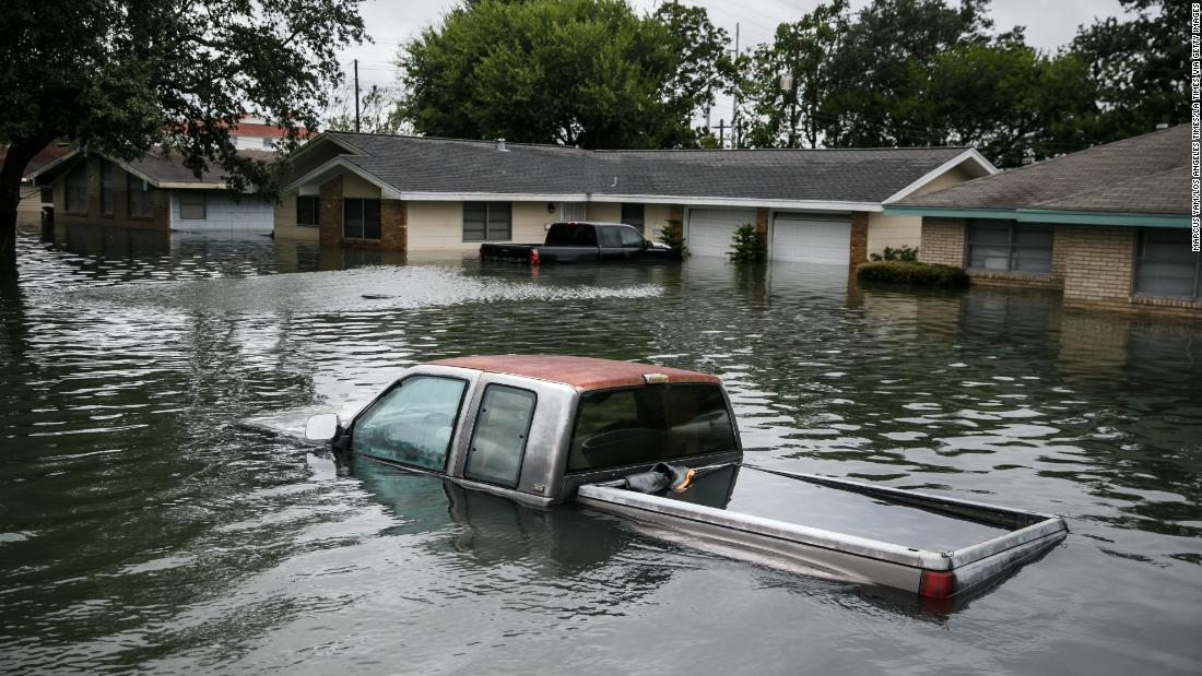 A truck is seen in floodwaters caused by 2017's Hurricane Harvey.