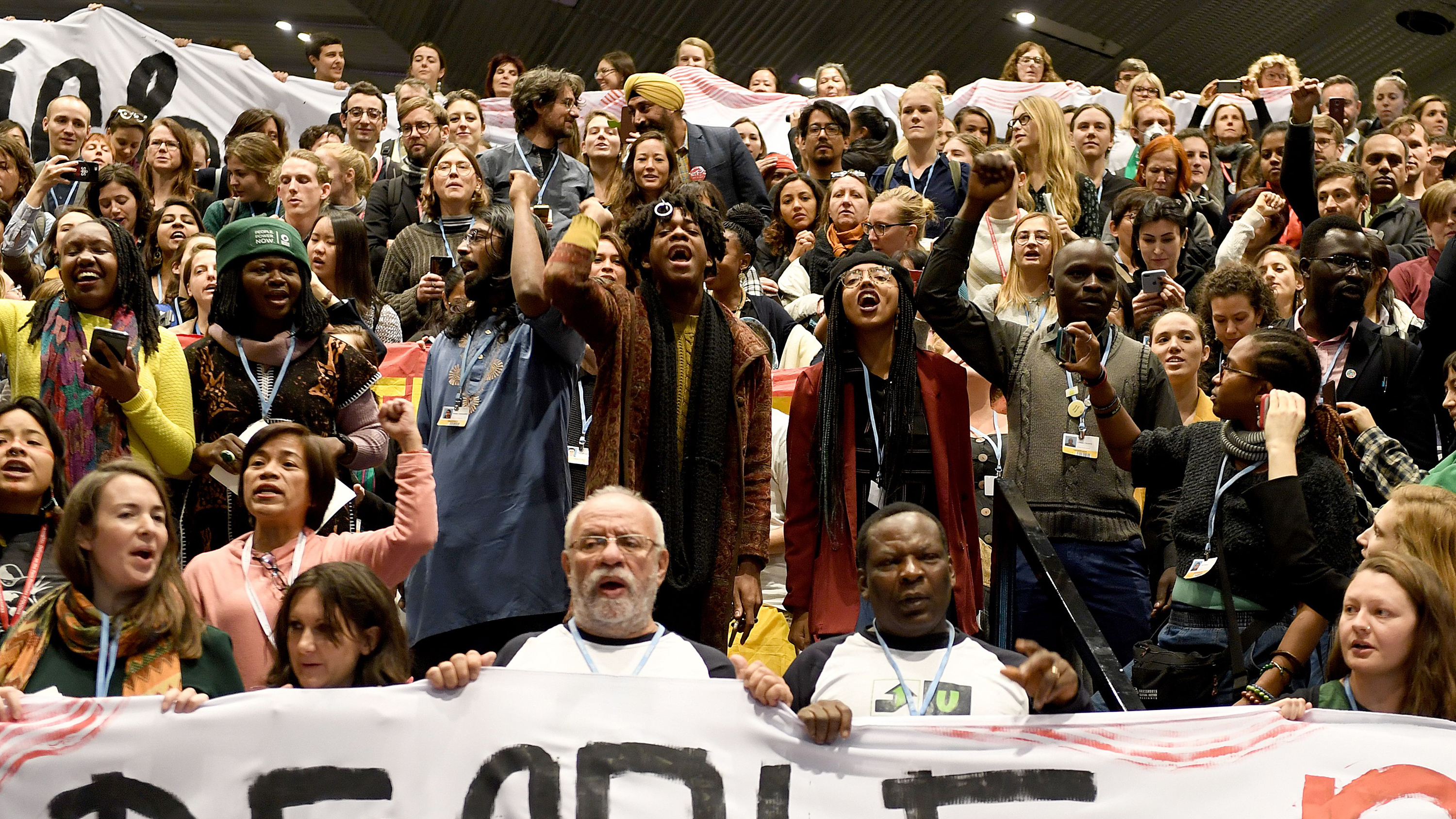 Members of the Global Campaign to Demand Climate Justice protest ahead of the final session of COP24 today.