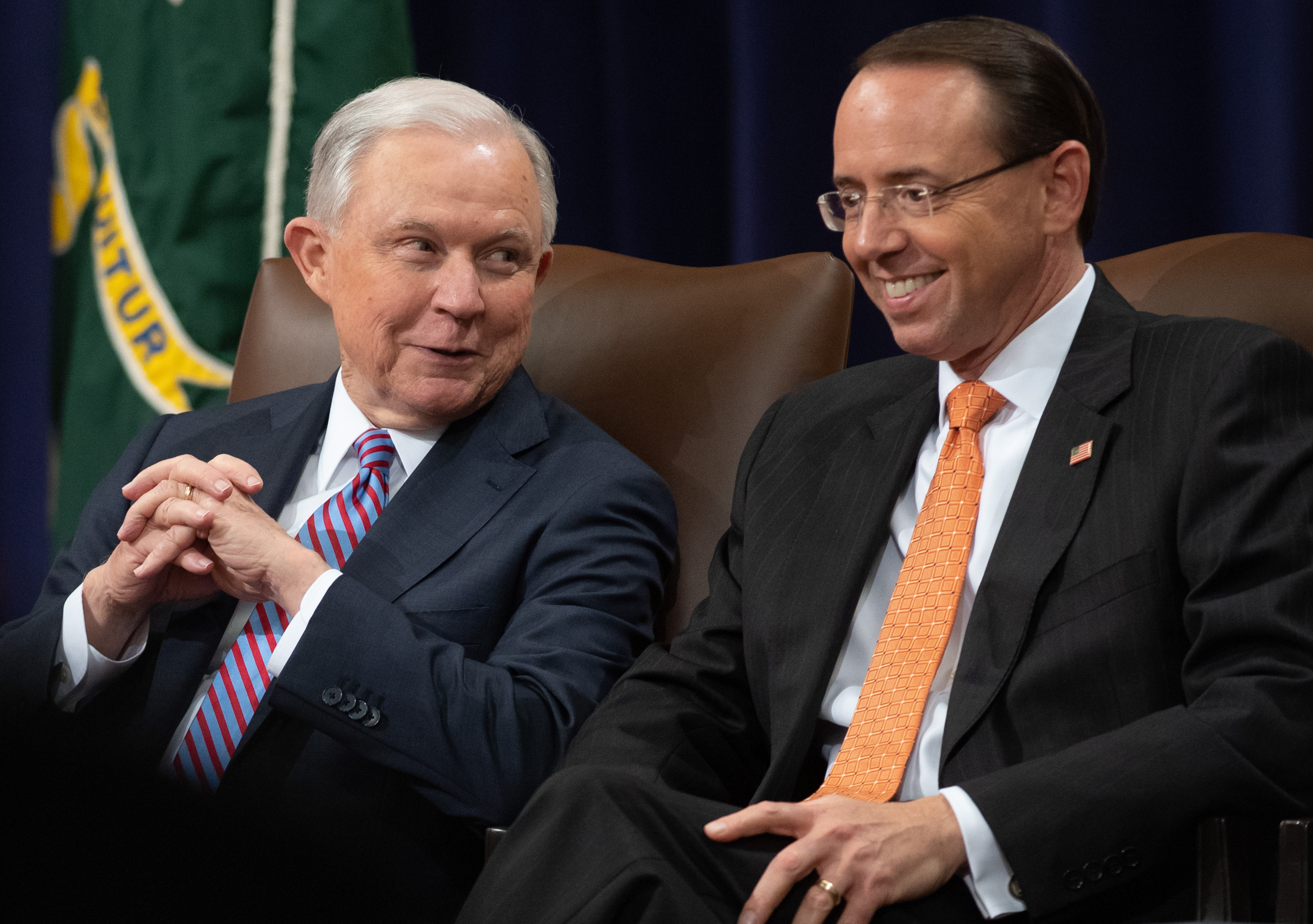 US Attorney General Jeff Sessions and Deputy Attorney General Rod Rosenstein (R) attend the Second Annual Attorney General's Award for Distinguished Service in Policing at the Department of Justice in Washington, DC, September 18, 2018.