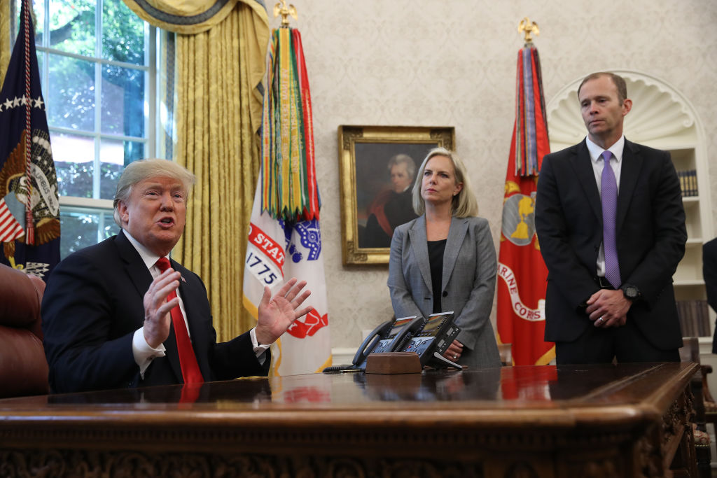 President Donald Trump (L) discusses the potential impact of Hurricane Michael with Homeland Security Secretary Kirstjen Nielsen (C) and FEMA Administrator Brock Long (R) in the Oval Office of the White House on Oct. 10, 2018 in Washington, DC.