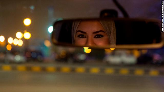Walaa Abou Najem, 30, drives her car through the streets of the capital Riyadh for the first time
