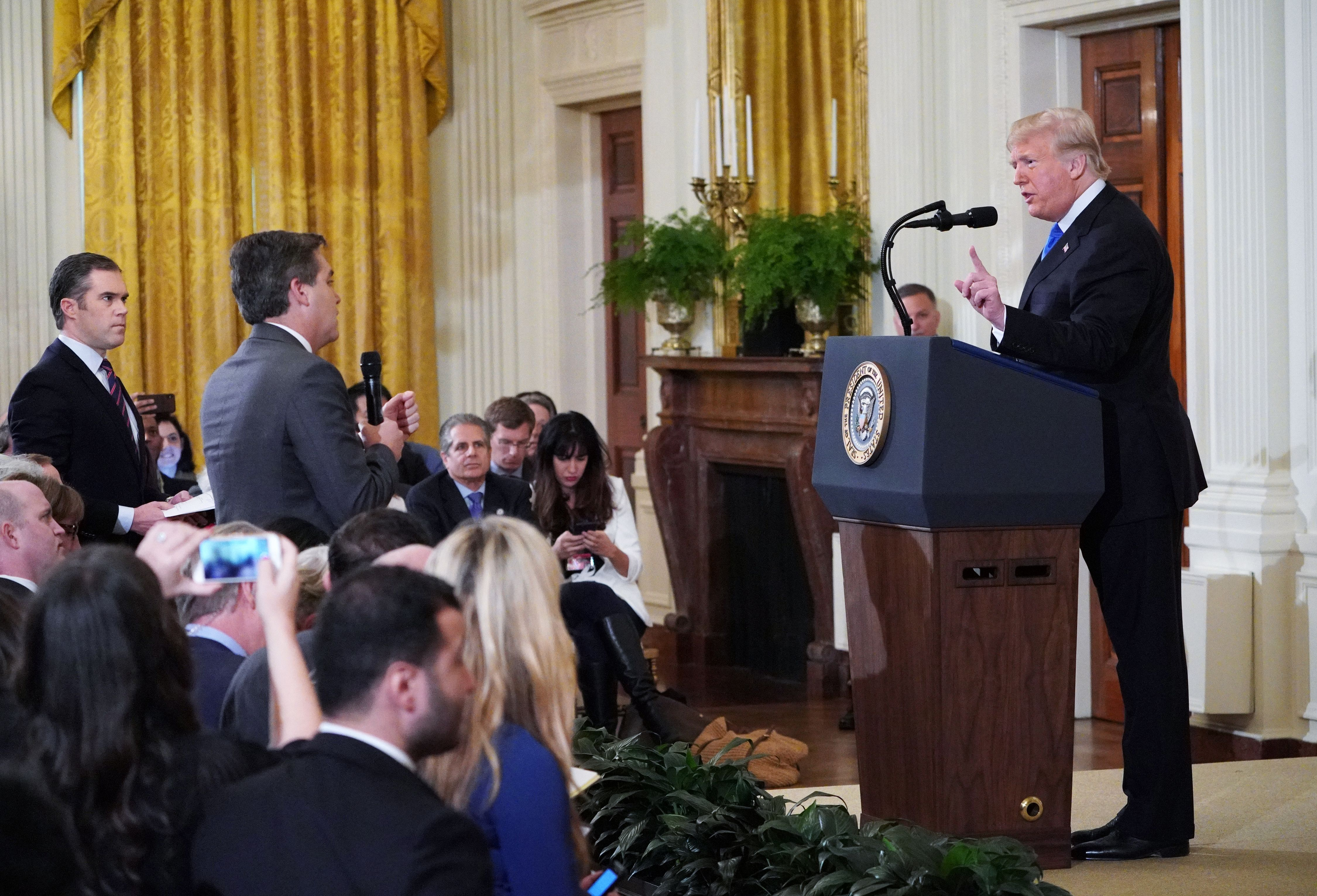 Trump gets into a heated exchange with CNN chief White House correspondent Jim Acosta (center) as NBC correspondent Peter Alexander (left) looks on.