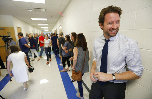 Democrat Joe Cunningham waits in line to vote at St. Andrews School of Math and Science in Charleston on Tuesday.