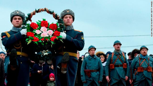 Russian honor guards carry wreaths at a war cemetery outside Saint Petersburg.