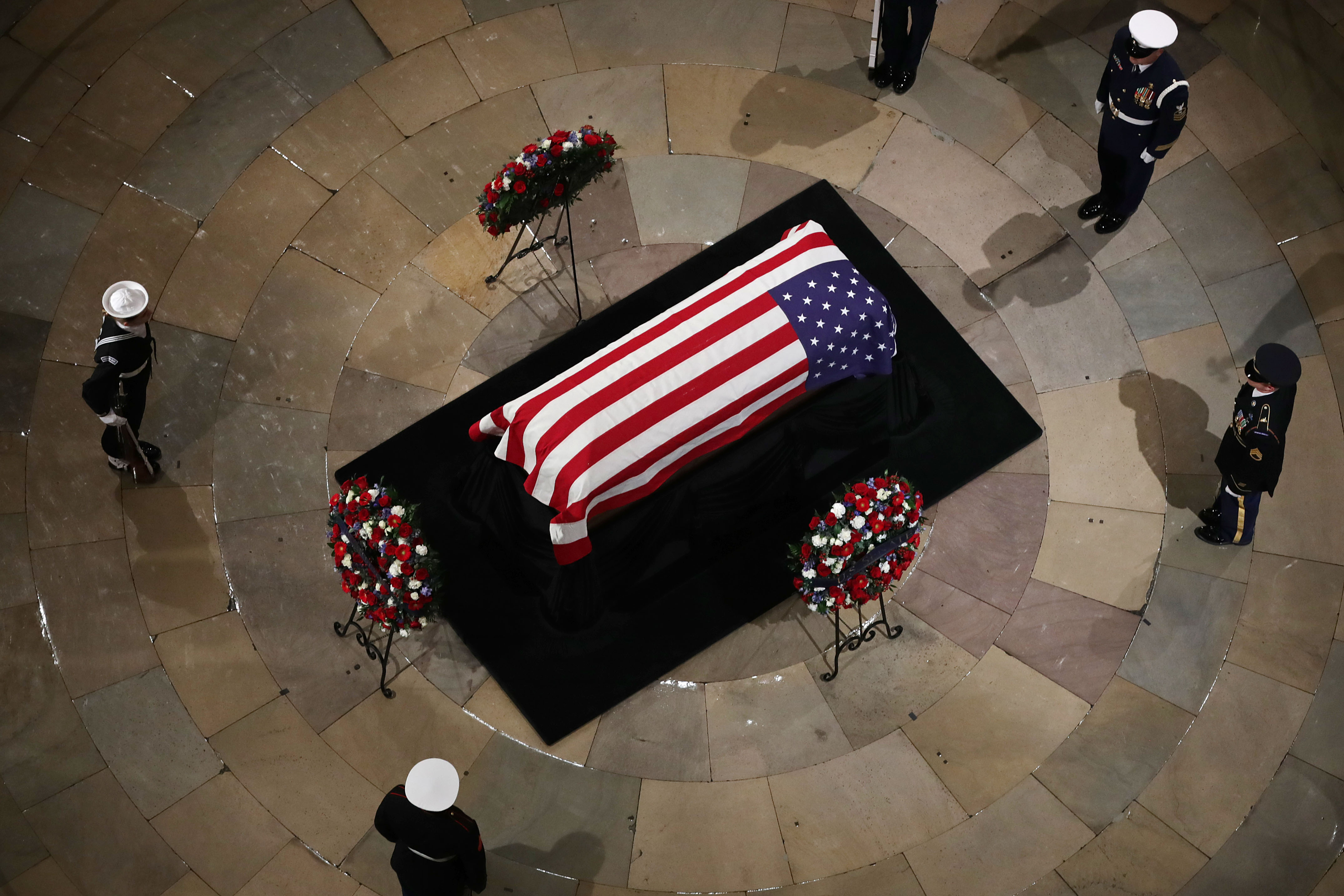 A US military honor guard stands watch as former U.S. President George H.W. Bush lies in state in the US Capitol Rotunda Dec.3, 2018 in Washington, DC.