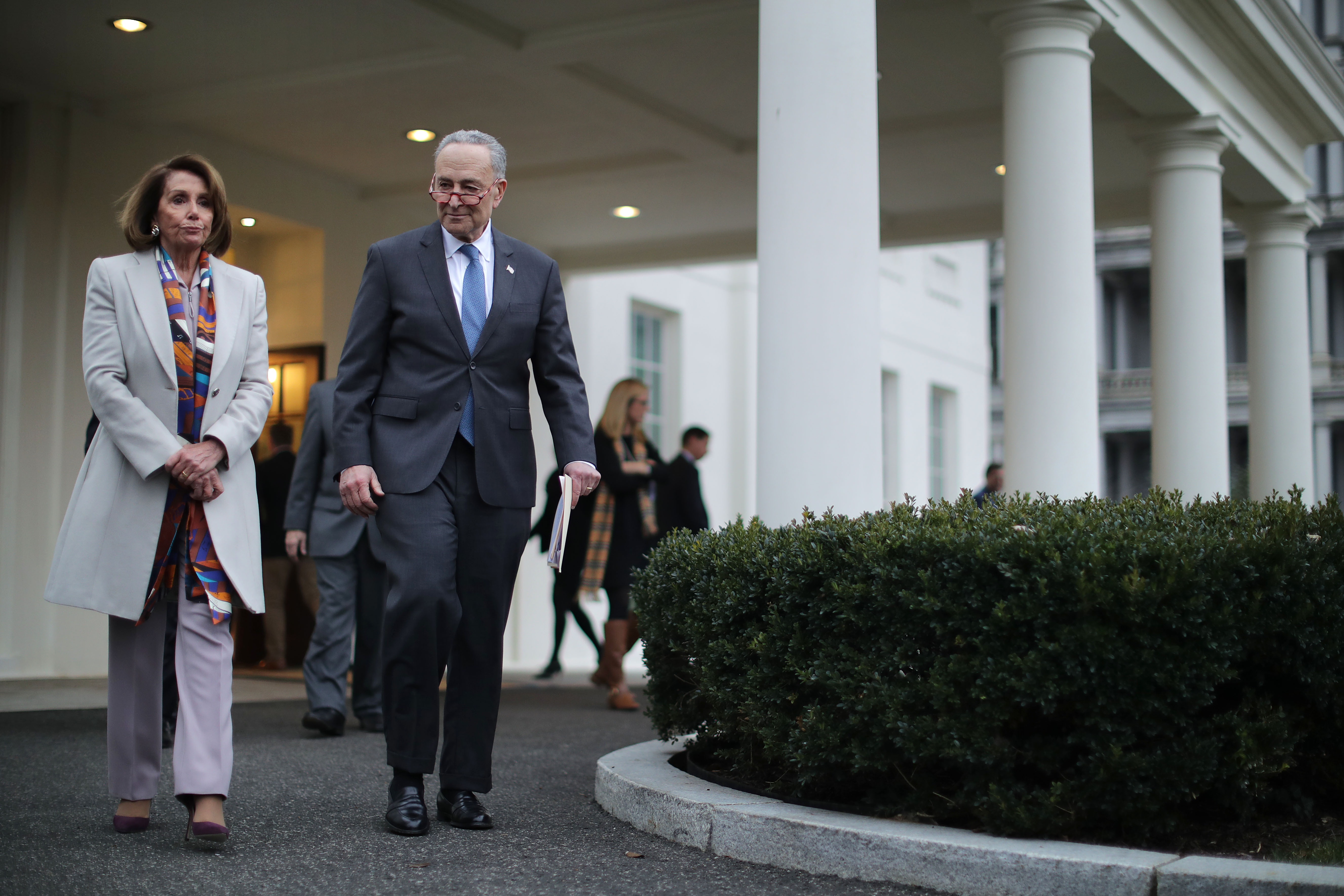 Democratic leaders Nancy Pelosi and Chuck Schumer leave the White House following a meeting with Trump on Wednesday.