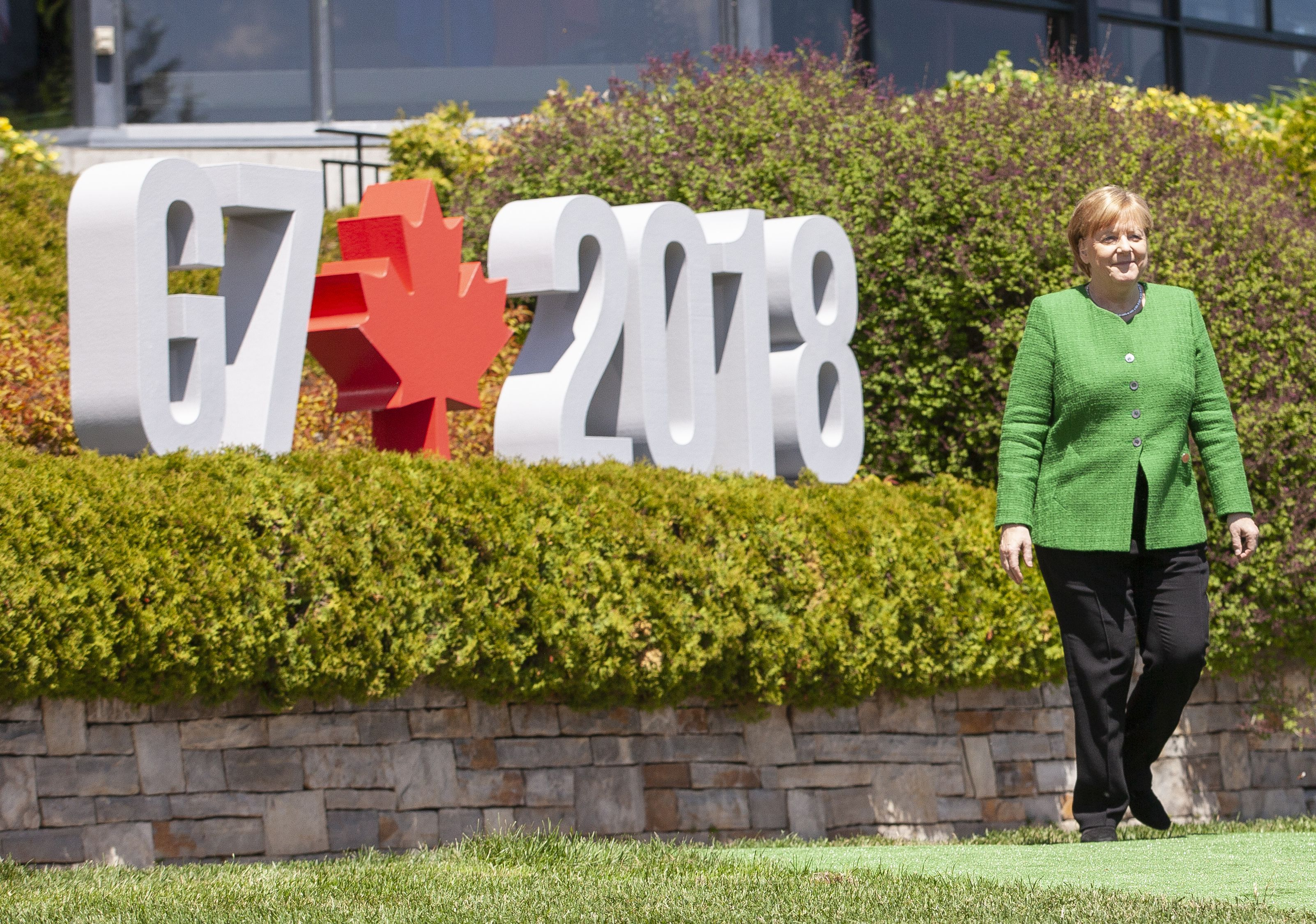 German Chancellor Angela Merkel walks to the official G7 welcoming ceremony in La Malbaie, Quebec, Canada.