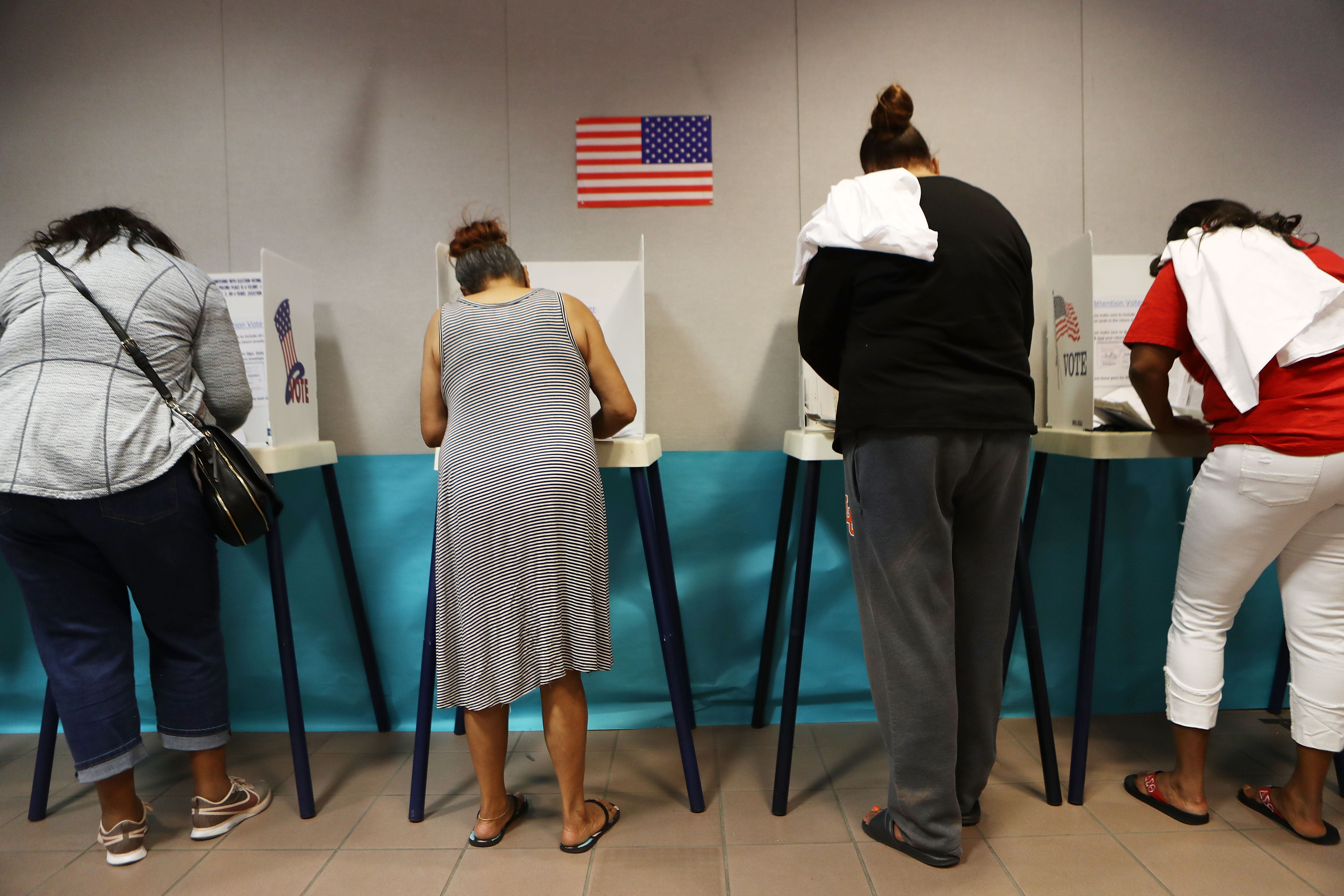Voters fill out their ballots during early voting in Lancaster, California.