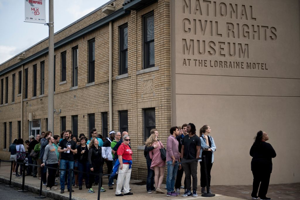People wait to visit the National Civil Rights Museum at the site of the Lorraine Motel, where Martin Luther King Jr. was assassinated, April 3, 2018 in Memphis, Tennessee. King was assassinated 50 years ago on April 4, 1968, as he stepped to the balcony.