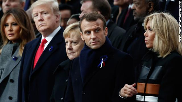 US First Lady Melania Trump, US President Donald Trump, German Chancellor Angela Merkel, French President Emmanuel Macron and his wife Brigitte.