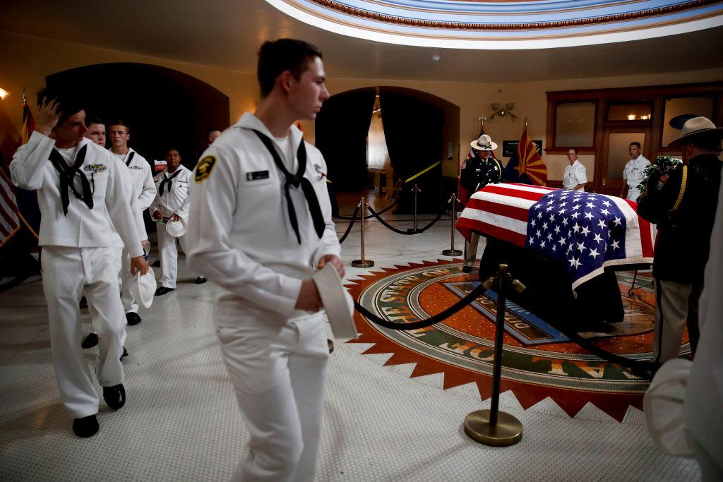 US Naval sea cadets walk past the casket during a memorial service in Phoenix, Arizona.