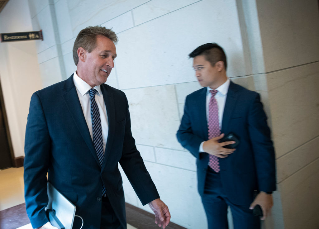 Sen. Jeff Flake (R-AZ) arrives at the Office of Senate Security, which houses a 'sensitive compartmented information facility,' or SCIF,  to view the the FBI report on Supreme Court nominee Judge Brett Kavanaugh on Oct. 4, 2018 in Washington, DC.