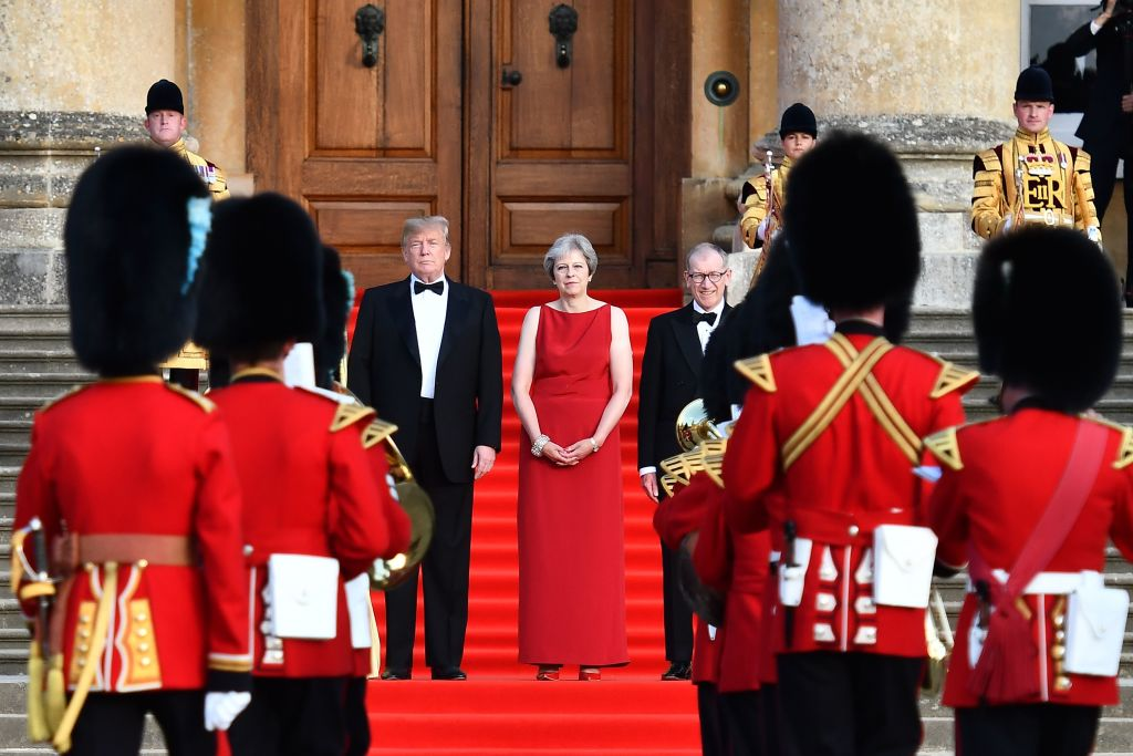 US President Donald Trump, Britain's Prime Minister Theresa May and her husband Philip May stand on steps in the Great Court at Blenheim Palace, west of London, on July 12, 2018.