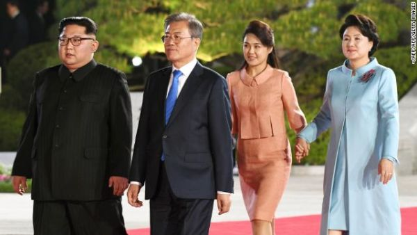 Kim Jong Un and South Korea's President Moon Jae-in walk with their wives following their historic summit in the demilitarized zone on April 27