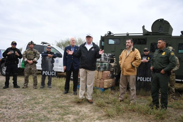 President Trump speaks after he received a briefing on border security next to Sen. John Cornyn (L) and Sen. Ted Cruz (2ndR) near the Rio Grande in McAllen, Texas, on Jan. 10, 2019.