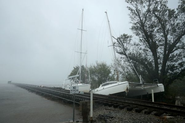 Broken from their moorings, boats are wrecked against a railroad bridge that crosses the Neuse River.