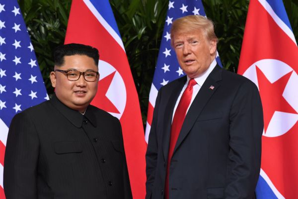 President Donald Trump meets with North Korea's leader Kim Jong Un at the start of their historic US-North Korea summit, at the Capella Hotel on Sentosa island in Singapore on June 12, 2018.