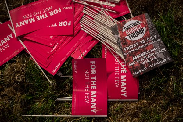 A leaflet for a July protest against Trump is seen amongst Labour party flags on June 16, 2018 in London, England.