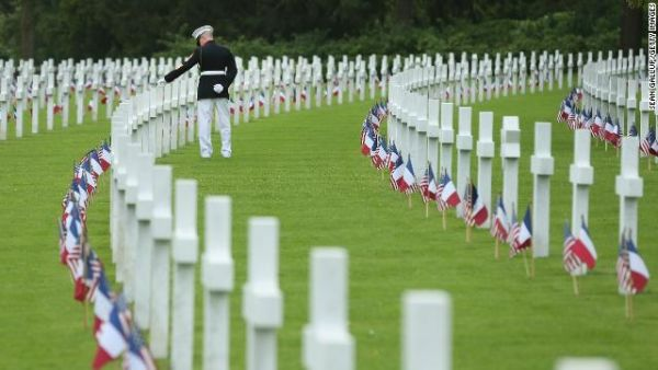 US Marine Sergeant Major Darrell Carver of the 6th Marine Regiment walks among the graves of US soldiers, most of them killed in the World War I Battle of Belleau Wood, during a ceremony in May 2018.