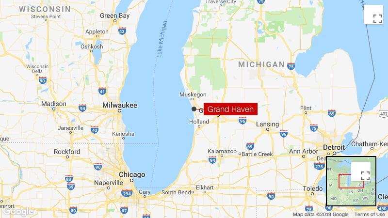 Money falls out of vehicle near Grand Haven