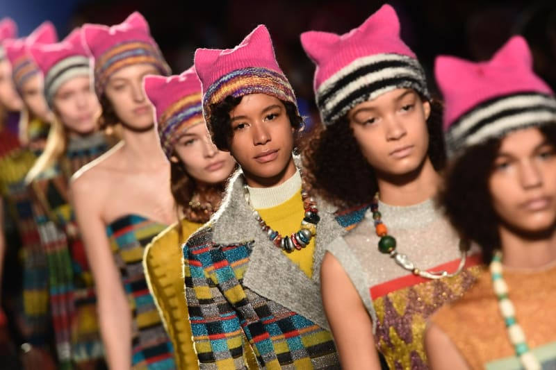 """Models wearing so-called """"pussyhats,"""" a symbol of women's rights, at Milan Fashion Week in 2017."""