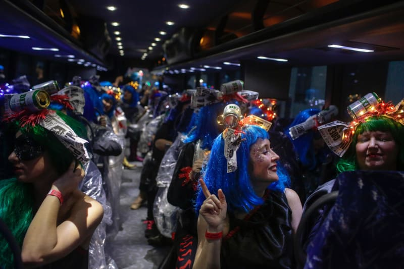 Members of the Krewe of Muses filled dozens of buses.