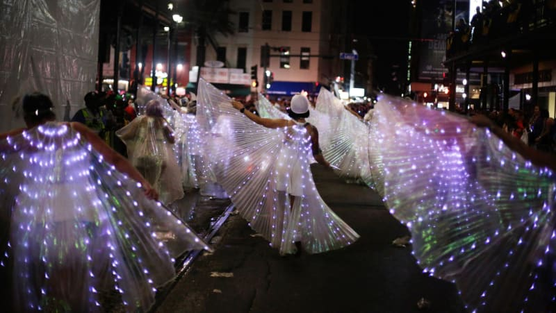 A marching group rolls with the Krewe of Muses through the streets of New Orleans.