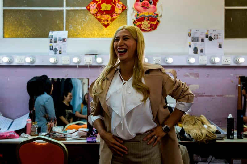 Actress Man Chan, pictured backstage, plays Ivanka Trump.