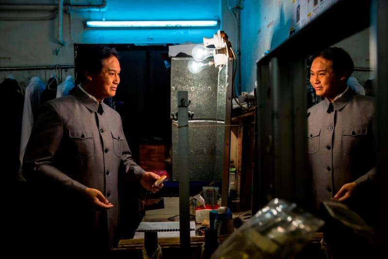 Loong Koon-tin, who also plays former Chinese leader Mao Zedong, prepares backstage during a rehearsal. Credit: ISAAC LAWRENCE/AFP/AFP/Getty Images