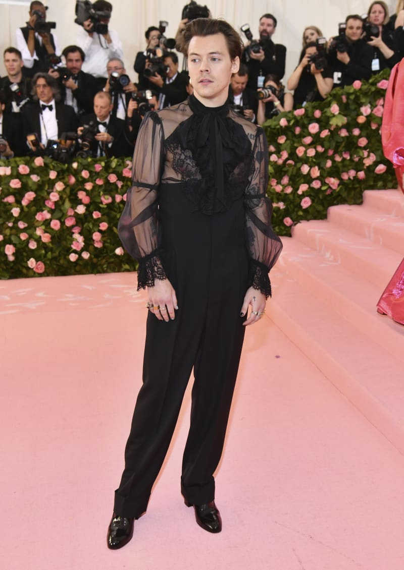 Harry Styles attends the Met Gala wearing Gucci.